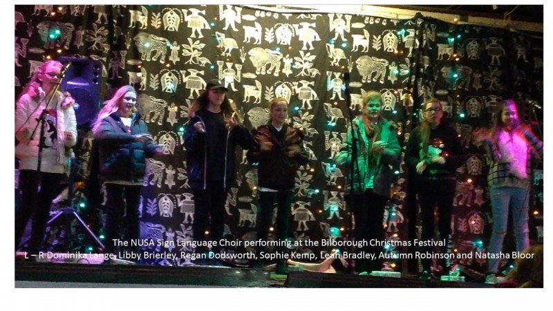 Nusa Signing choir performing at the Bilborough Festival, Bracebridge Drive on the 7th December 2017